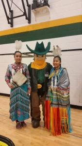 Here Kiara and Aislinn pose with the Rustler mascot at the games... UNREAL night.